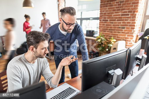 istock Teamwork concept. People working with new startup project. 832112488