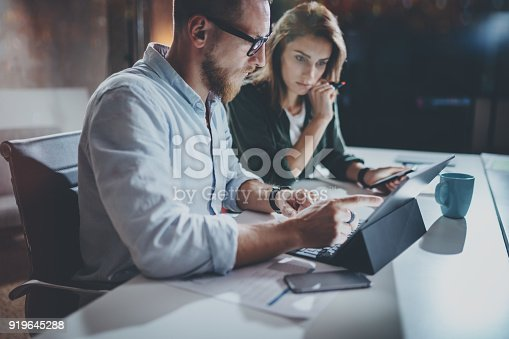 istock Teamwork concept.Project team making conversation at meeting room at office.Horizontal.Blurred background.Flares. 919645288