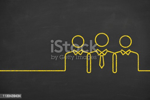 istock Teamwork Concepts with Business Person on Chalkboard Background 1133439434