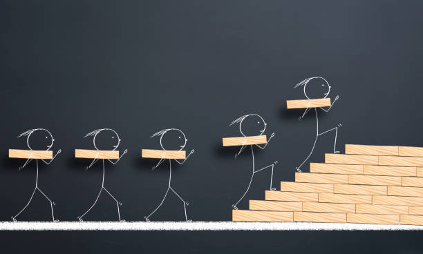 teamwork concept.Team members carry the blocks on their shoulders and make stairs to success teamwork concept.Team members carry the blocks on their shoulders and make stairs to success improvement stock pictures, royalty-free photos & images