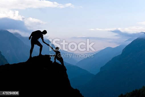 istock Teamwork couple climbing helping hand 475294806