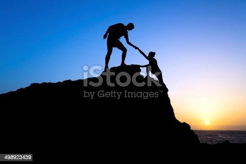 istock Teamwork, couple help silhouette 498923439