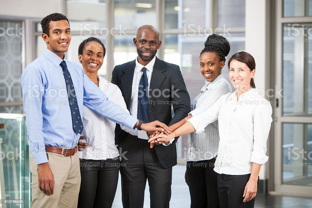 Teamwork from a group of 5 business people stock photo