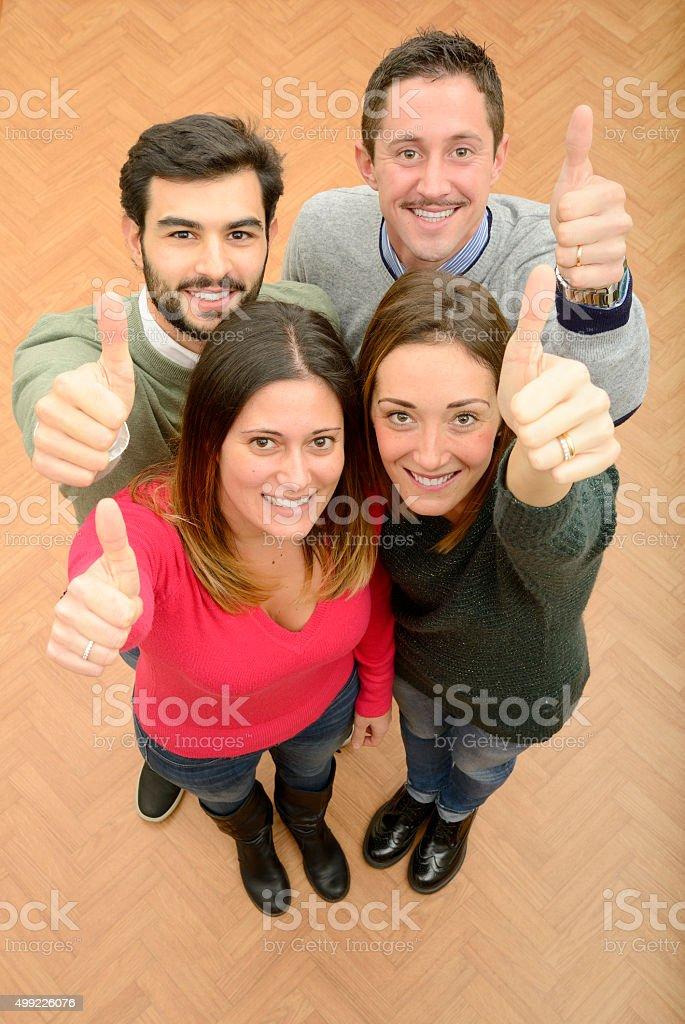 Teamwork giving thumbs up stock photo