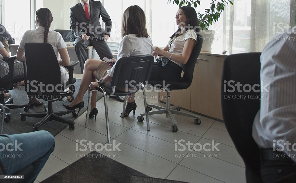 Teamwork - group of people in office; meeting or training; stock photo