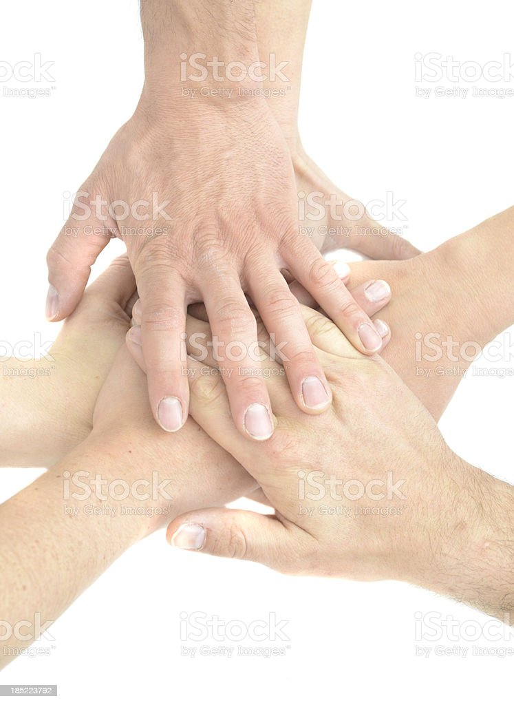 Teamwork hands in the middle royalty-free stock photo
