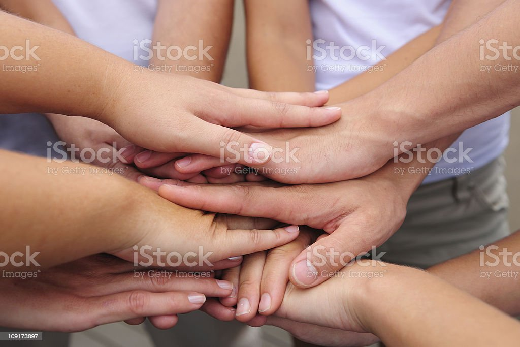Teamwork: Hands together stock photo