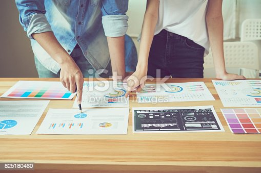istock Teamwork helps us select the best information. To bring to customers to use in successful work. Quality work concept, vintage effect. 825180460