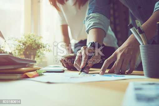 istock Teamwork helps us select the best information. To bring to customers to use in successful work. Quality work concept, vintage effect. 825180614