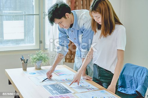 istock Teamwork helps us select the best information. To bring to customers to use in successful work. Quality work concept, vintage effect. 832686104