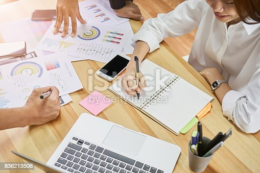 istock Teamwork helps us select the best information. To bring to customers to use in successful work. Quality work concept, vintage effect. 836213506
