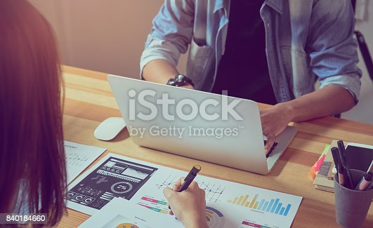 istock Teamwork helps us select the best information. To bring to customers to use in successful work. Quality work concept, vintage effect. 840184660