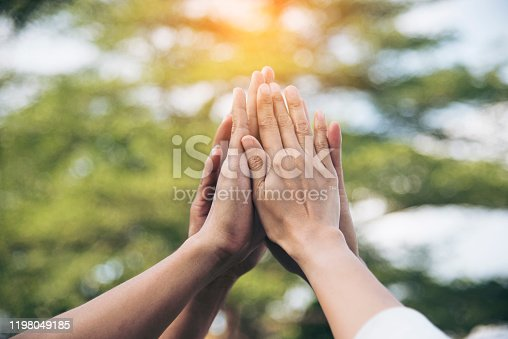 Teamwork high five as team together hands air greeting  power tag team. Group of diversity people multiethnic