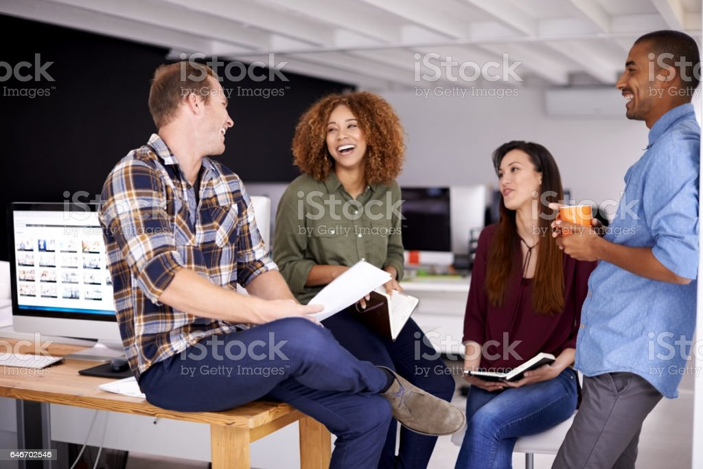 Teamwork holds the capacity for increased office morale stock photo