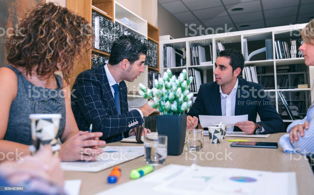 Teamwork in a business meeting on headquarters stock photo