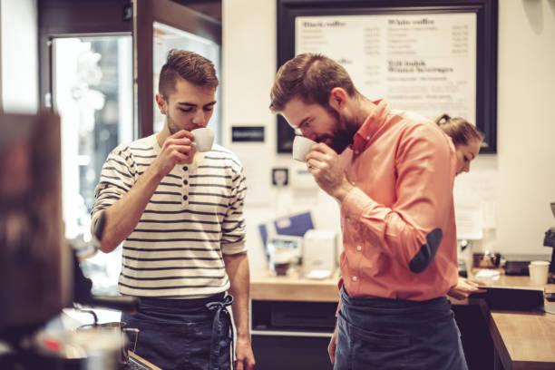 Teamwork in a coffee shop stock photo