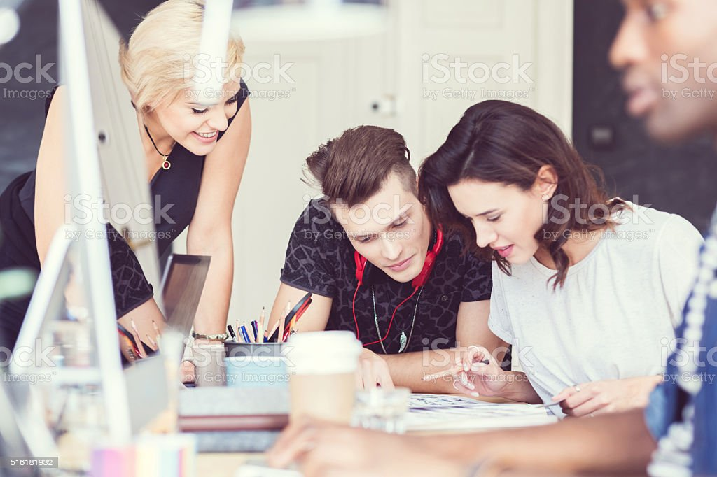 Teamwork in a creative agency stock photo