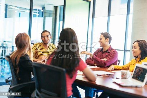 istock Teamwork in Latin millennial business start up 1128646992
