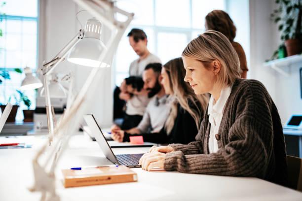 Teamwork in modern coworking space stock photo