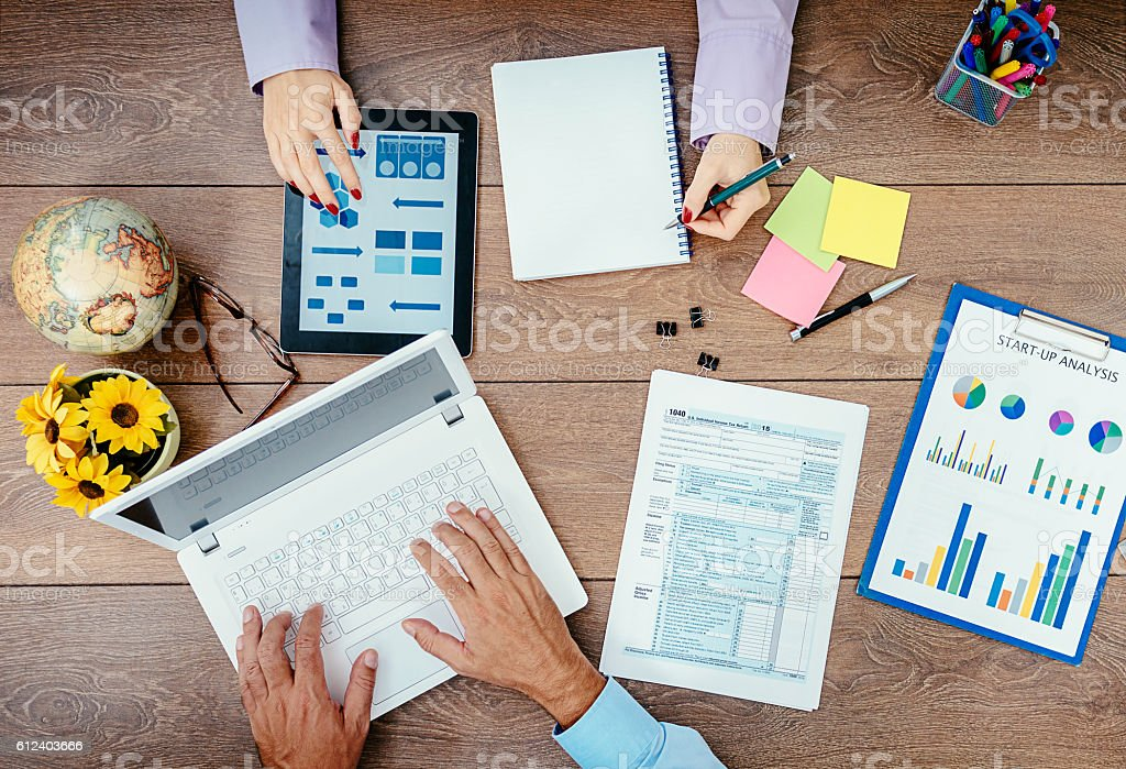 Teamwork in office with two employees stock photo