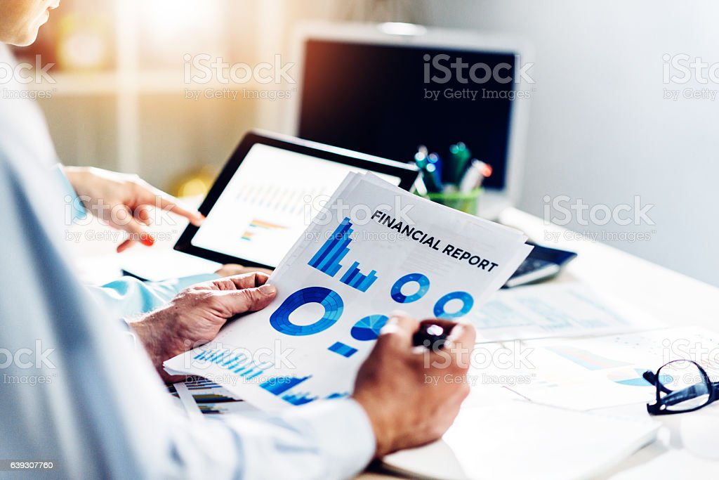 Teamwork in office with two finance employees stock photo