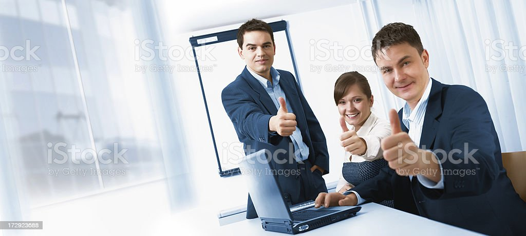 Teamwork in the office. All member showing success royalty-free stock photo