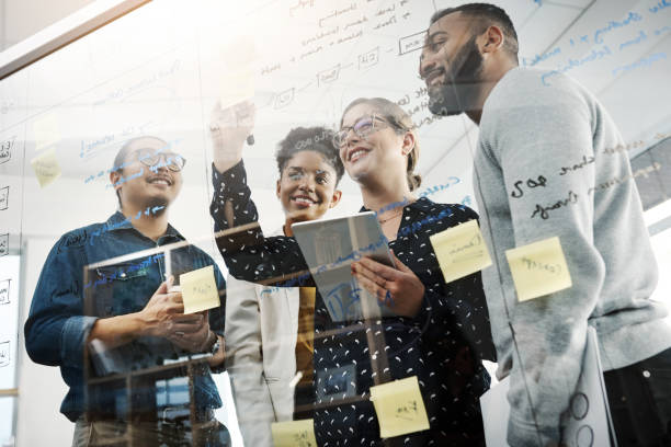 Teamwork makes the brainstorm work Shot of a group of young businesspeople having a brainstorming session in a modern office brainstorming stock pictures, royalty-free photos & images