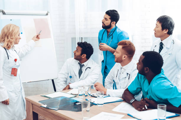 Teamwork Medical Consultation With Head Doctor. stock photo