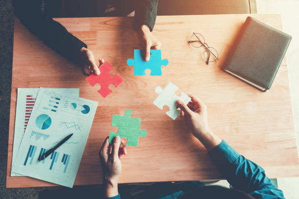 Teamwork meeting Business Jigsaw Puzzle solution together concept stock photo