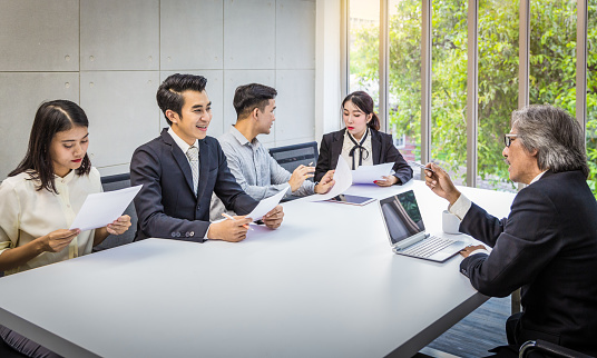 672116416 istock photo Teamwork meeting in board room with senior CEO 989467296