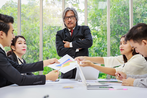 672116416 istock photo Teamwork meeting in board room with senior project managers 989467222
