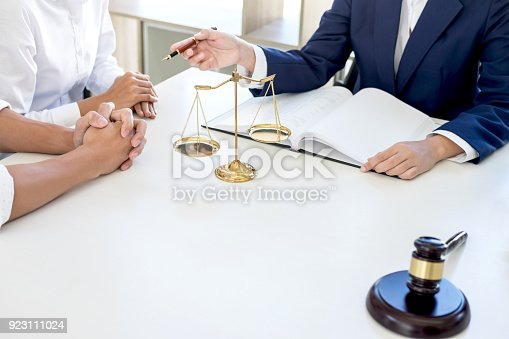 istock Teamwork of business lawyer colleagues, Having meeting with team at law firm, Consultation and conference between a female lawyer and customer tax and contract the company of real estate concept 923111024