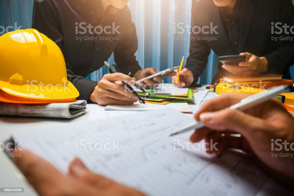 Teamwork of business man contractor working meeting in the office construction site on their architect project. stock photo
