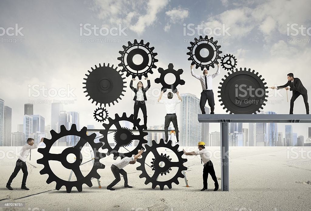 Teamwork of businesspeople Teamwork of businesspeople at work to build a business system Activity Stock Photo