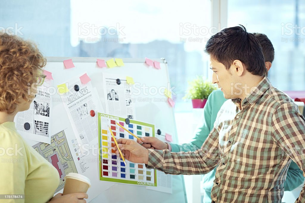 Teamwork of designers stock photo