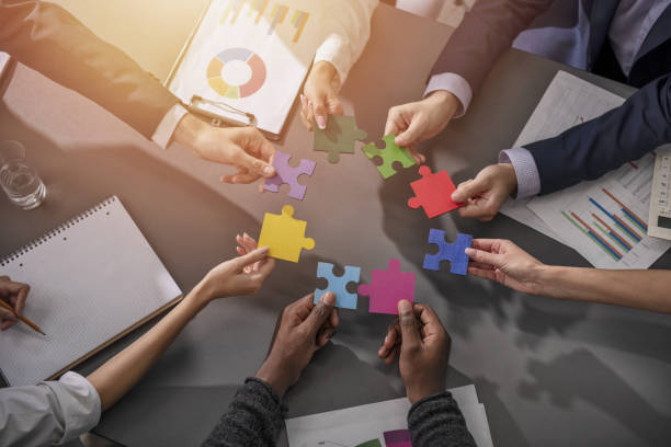 Teamwork of partners. Concept of integration and startup with puzzle pieces - foto stock
