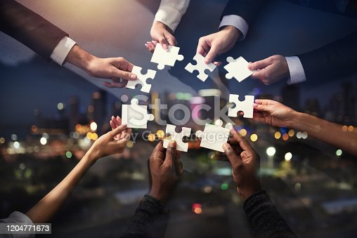 Businessmen working together to build a puzzle. Concept of teamwork, partnership, integration and startup. Double exposure