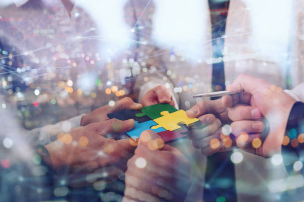 Teamwork of partners. Concept of integration and startup with puzzle pieces stock photo