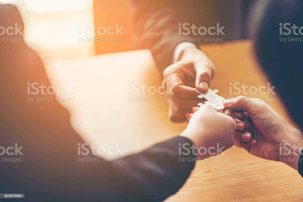 Teamwork of partners. Concept of integration and startup with puzzle pieces. double exposure stock photo