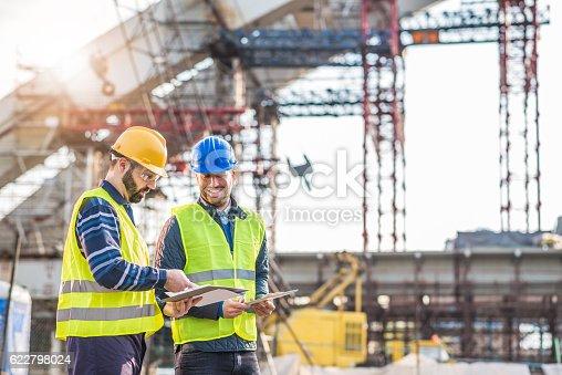 istock Teamwork on construction site working on bridge construction 622798024