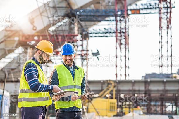 Teamwork on construction site working on bridge construction picture id622798024?b=1&k=6&m=622798024&s=612x612&h=eflubb60nwa o4wfiqe hojpbzvewxvlobao49alz4o=