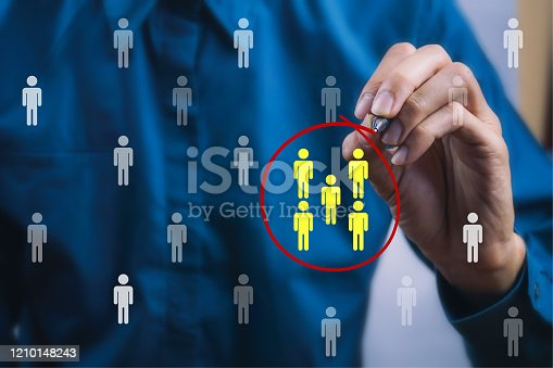 istock Teamwork or focus niche marketing concept. A businessman write a red line circle around yellow businessman icon. 1210148243