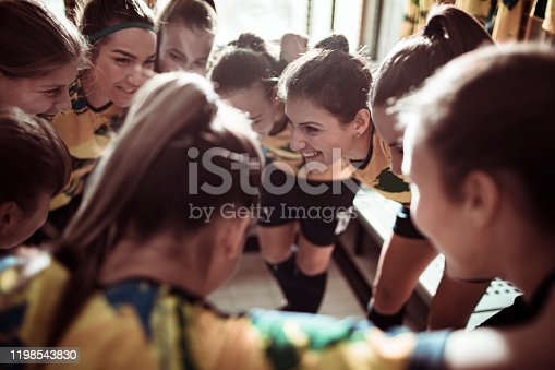 Close up of a female soccer team having a motivational speech before an important game