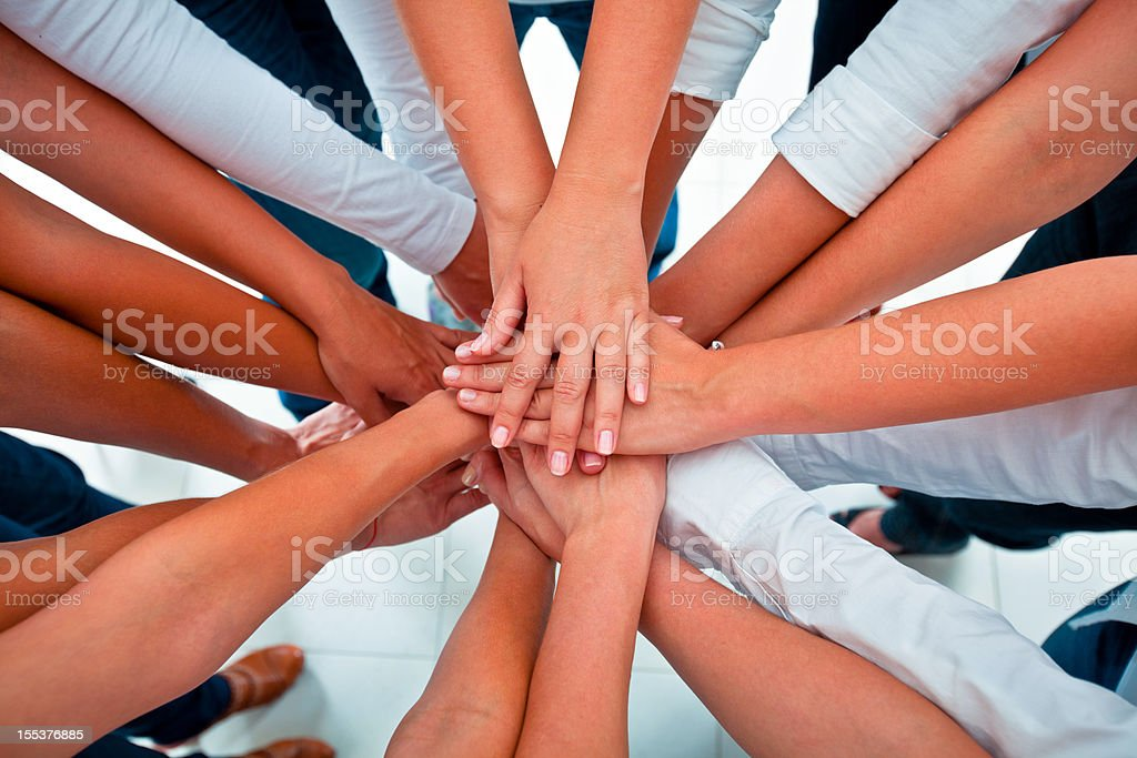 Teamwork Teamwork concept. Group of women joining hands. Elevated view. Adult Stock Photo