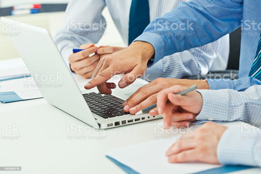 Teamwork Three businessman discussing project on laptop. Close-up on male hands. Adult Stock Photo
