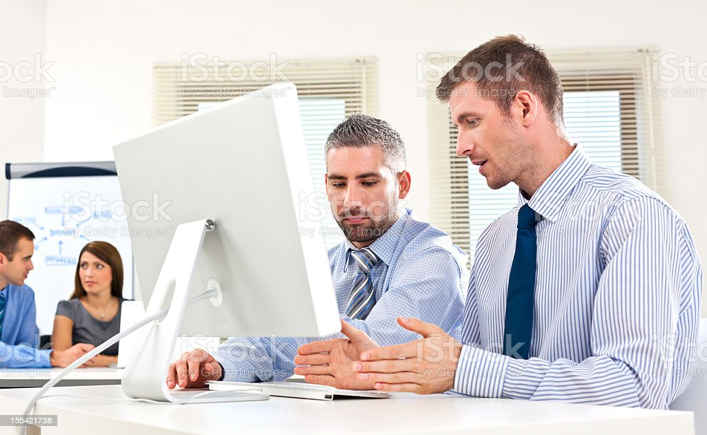 Teamwork Business colleagues working together on the computer in an office. 30-34 Years Stock Photo