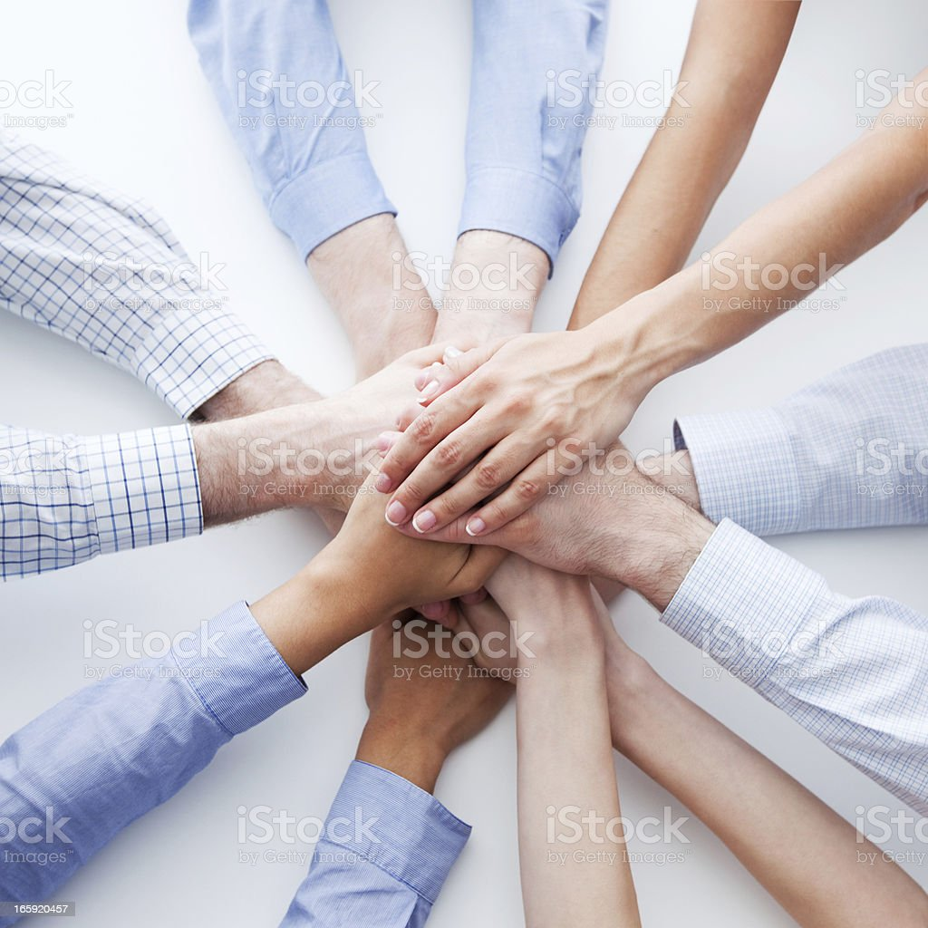 Teamwork Teamwork concept. 12 hands of business people joining hands. Elevated view, white background. Agreement Stock Photo