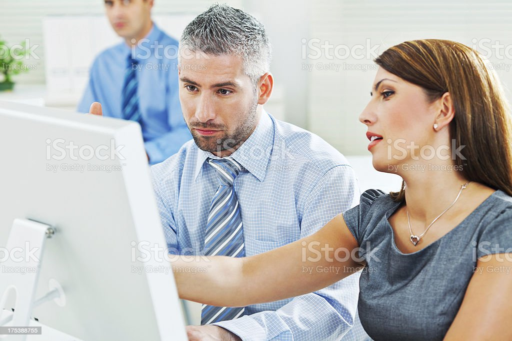 Teamwork Business colleagues working together on the computer in an office. Adult Stock Photo