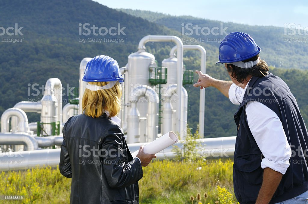 Teamwork Planning in a Geothermal Power Station royalty-free stock photo