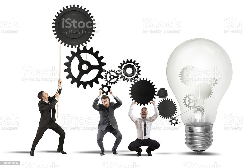 Teamwork powering an idea stock photo